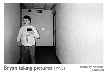 Bryan in 1995 taking pictures at Governor Morehead School. Photo by Antonio, who was a classmate of Bryan's.
